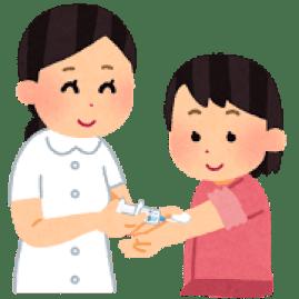 インフルエンザの予防接種を受ける子供