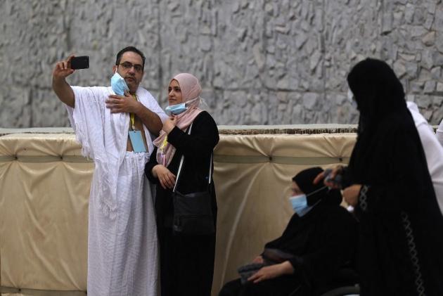 Muslim worshippers take selfies.