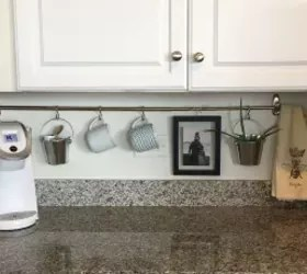 kitchen updates kohler cast iron sink 15 clever you can do for under 20 hometalk s hang up a curtain rod
