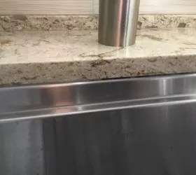 how to clean caulking turned black