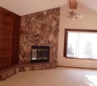 Help! Can you help redo this living room? Rock, brick ...