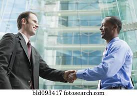 商人. 握手. 由于. a. 機器人 攝影圖庫   bld255155   Fotosearch