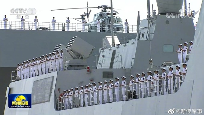 A destroyer was also commissoned at the same time as the assault ship. Photo: Weibo