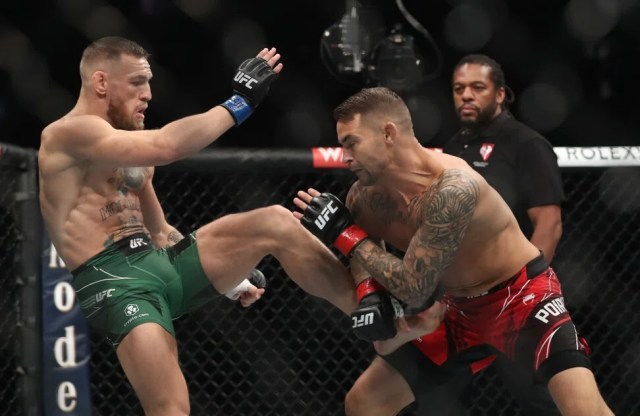 Conor McGregor kicks Dustin Poirier. Photo: Reuters