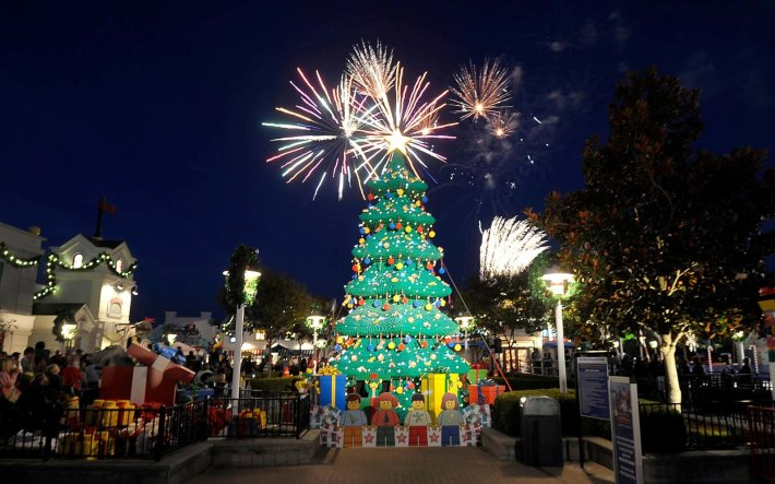 The Legoland Christmas Tree in Carlsbad,  California | Not all Christmas trees are glittering, light-filled pines. Some are made of chainsaws or sand. Others are towering collections of skis and tumbleweeds. Read on for the world's strangest Christmas trees.
