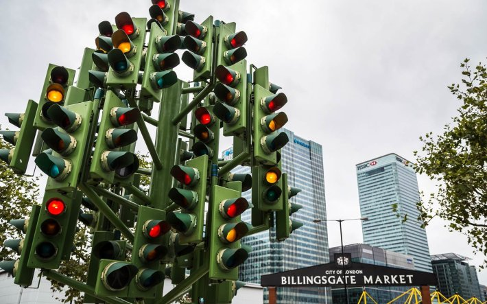 The Traffic Light Tree in London,  England | Not all Christmas trees are glittering, light-filled pines. Some are made of chainsaws or sand. Others are towering collections of skis and tumbleweeds. Read on for the world's strangest Christmas trees.