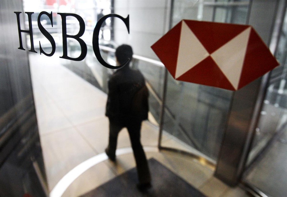 A man walks past a logo of HSBC Holdings PLC at the bank's headquarter in Hong Kong — March 2, 2009 (AP Photo/Vincent Yu)