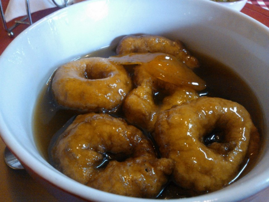 Visit Peru Image: Delicious fried sweet potato dough swims in a sweet brown broth of raw sugar syrup.