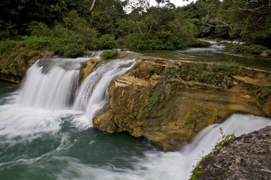 Swimming Holes Image: A photograph of the rocky and rushing Río Blanco waterfalls.