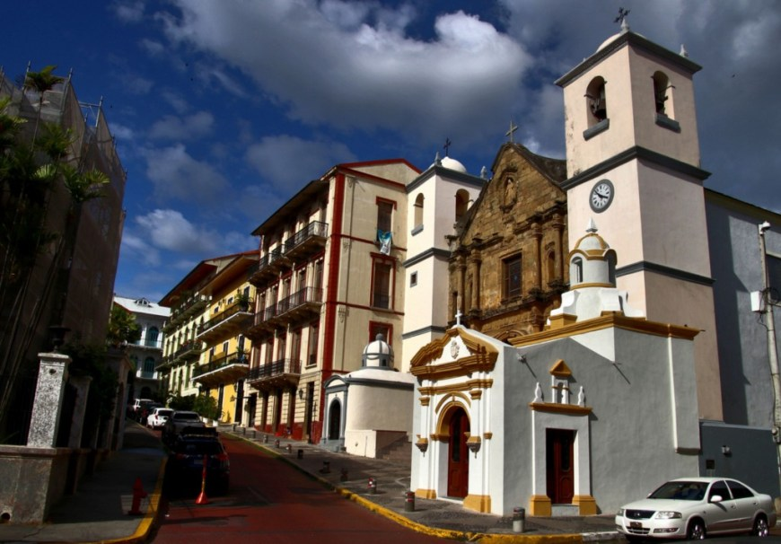 Architecture In Panama Image: A street corner of Casco Viejo shows a mix of both architecture and colour; a blue sky and clouds rolling in are seen from above.