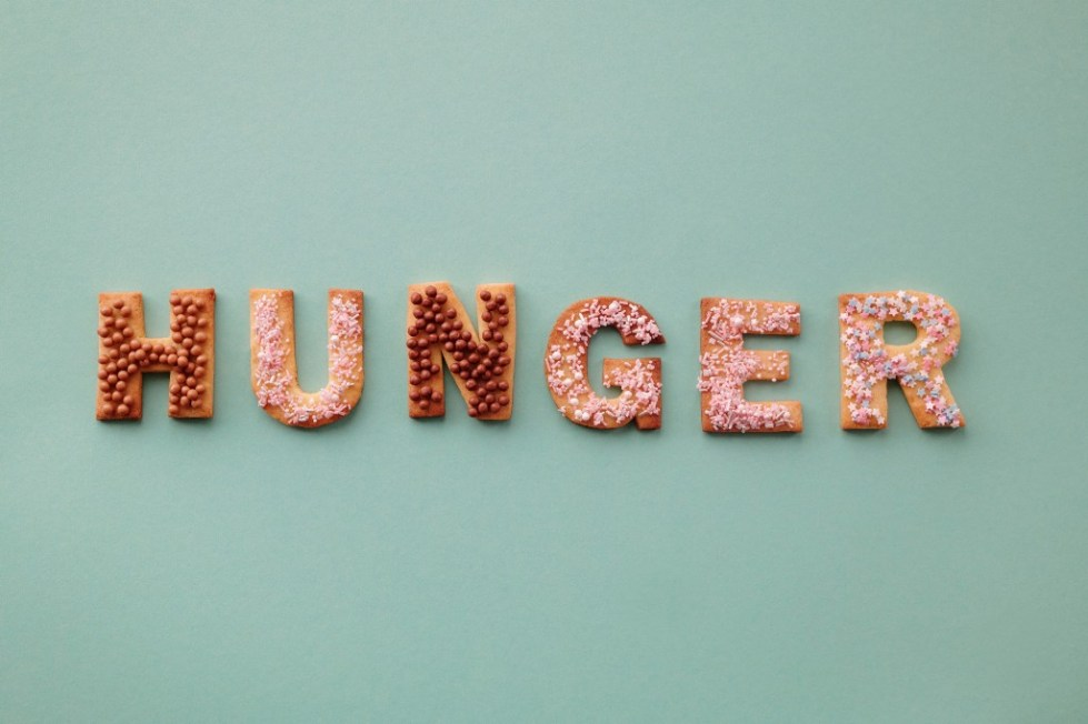"""Cookies that are cut into letters and arranged to spell the word """"HUNGER"""""""