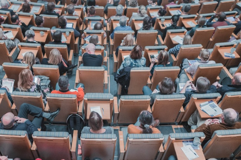 University classroom filled with people sitting on chairs