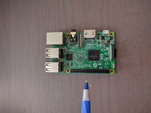 small resolution of pen is pointing to the pins on the bottom of the raspberry pi