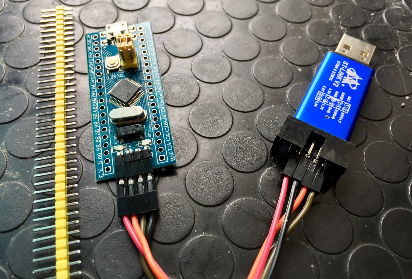 hight resolution of stm32 blue pill with headers left and st link v2 usb debugger right