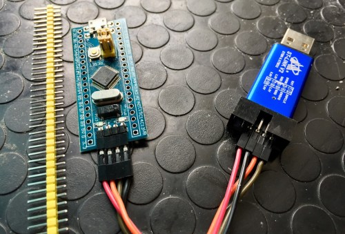 small resolution of stm32 blue pill with headers left and st link v2 usb debugger right