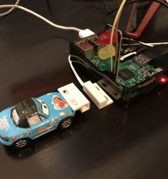 use the fun tak to hold the door sensor down to the desk in front of the raspberry pi and the door sensor magnet to the front of the car like so  [ 1600 x 1200 Pixel ]