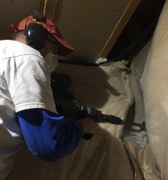 using a hammer drill and a carbide tip hole saw drill to create an exit hole to run a condensation drain line electrical and pressurized supply lines to an  [ 1600 x 1200 Pixel ]