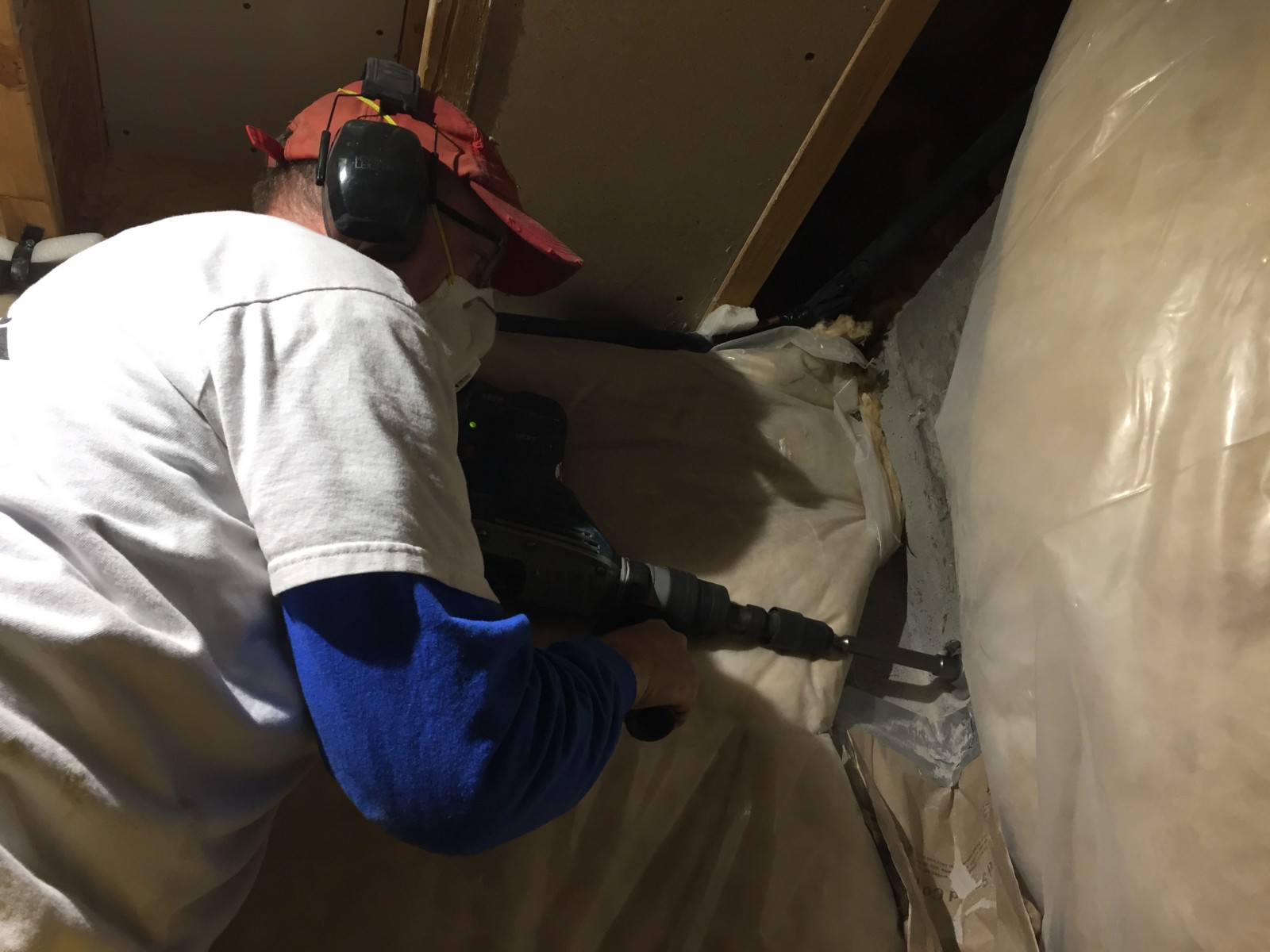hight resolution of using a hammer drill and a carbide tip hole saw drill to create an exit hole to run a condensation drain line electrical and pressurized supply lines to an