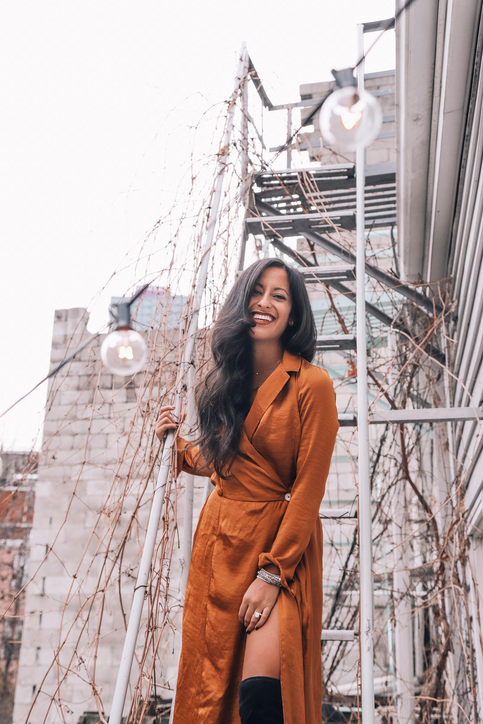 Adriana Carrig (Botti), the founder of Little Words Project wearing Bastet Noir's marigold shirt dress