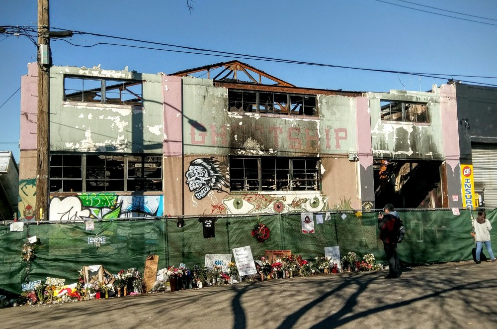 medium resolution of a makeshift memorial takes shape outside of the ghost ship in the days following the deadly fire which killed 36 source wikimedia commons