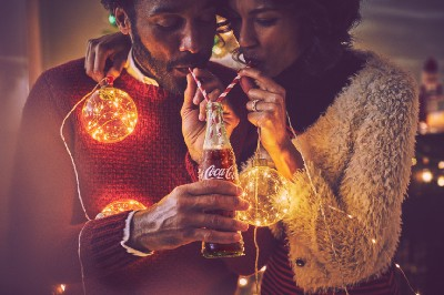 Cocacola brand photography voupledrinking with straws from bottle