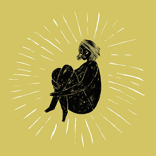 Description: In the centre of the image, a person, painted in black, sits with their legs folded and arms wrapped around them. White lines radiate around the figure and the background is yellow-green.