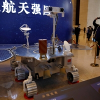 A replica of the Zhurong Mars rover is displayed during an exhibition inside the National Museum in Beijing in March. | REUTERS