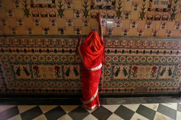 A woman prays in a Hindu temple in Kolkata, India, March 2017