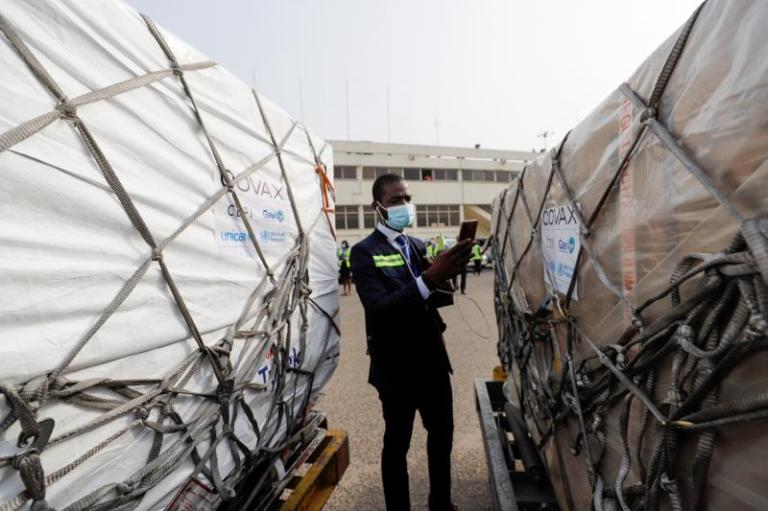 A worker checks boxes of COVID-19vaccines inAccra, Ghana, February 2021