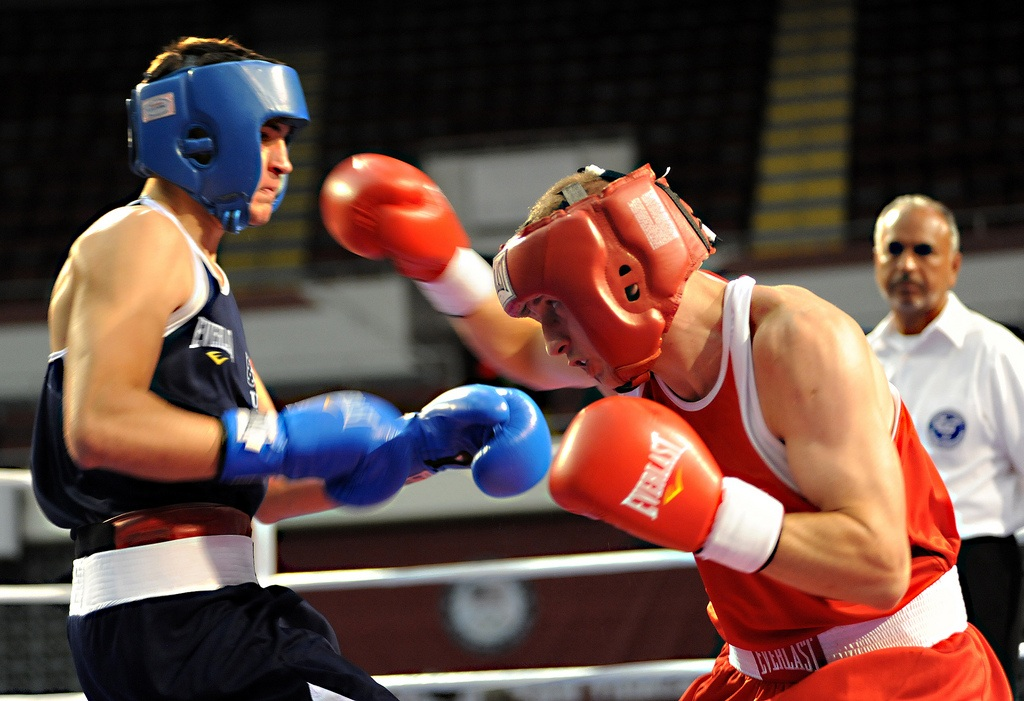 U.S. Army World Class Athlete Program boxer Spc. Samuel Vasquez (right) of Fort Carson, Colo., throws a right hand at Bryant Parrella of Lehigh Acres, Fla., en route to an 18-10 victory in the 152-pound challengers bracket semifinals of the U.S. Olympic Team Trials for Men's Boxing on Wednesday night at the Mobile Civic Center in Mobile, Ala. Vasquez will face Amir Imam of Albany, N.Y., on Thursday night in the challengers bracket finale at 152 pounds. The winner of that bout will meet Errol Spence of Desoto, Texas, on Friday for a spot on the 2012 U.S. Olympic Team. U.S. Army photo by Tim Hipps, IMCOM Public Affairs