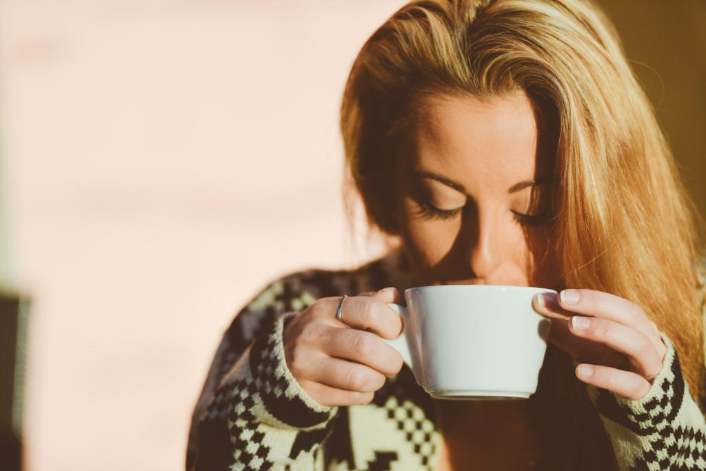 Blond Girl Peacefully Drinking Coffee At Sunrise_