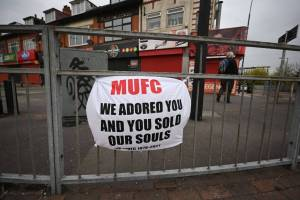 Man Utd fans protesting the Glazers block the entrance to the Carrington training ground