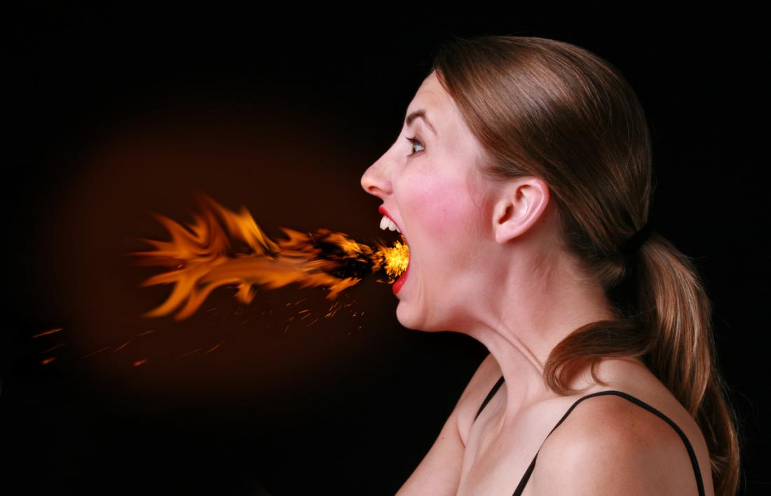 Woman with fire coming out of her mouth