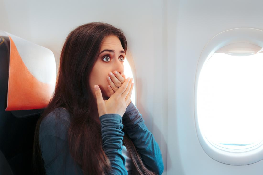 Scared woman on an airplane