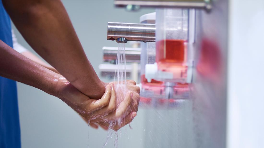 a medical professional washing their to help stop the spread of MRSA
