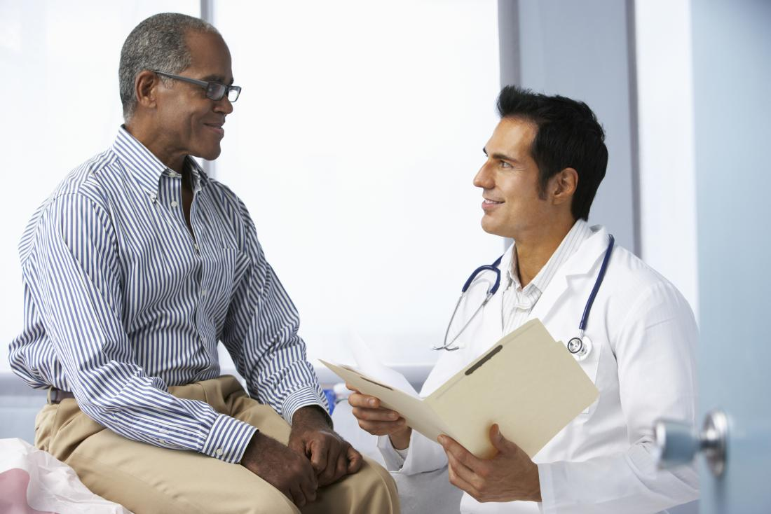 doctor discusses HIV with patient