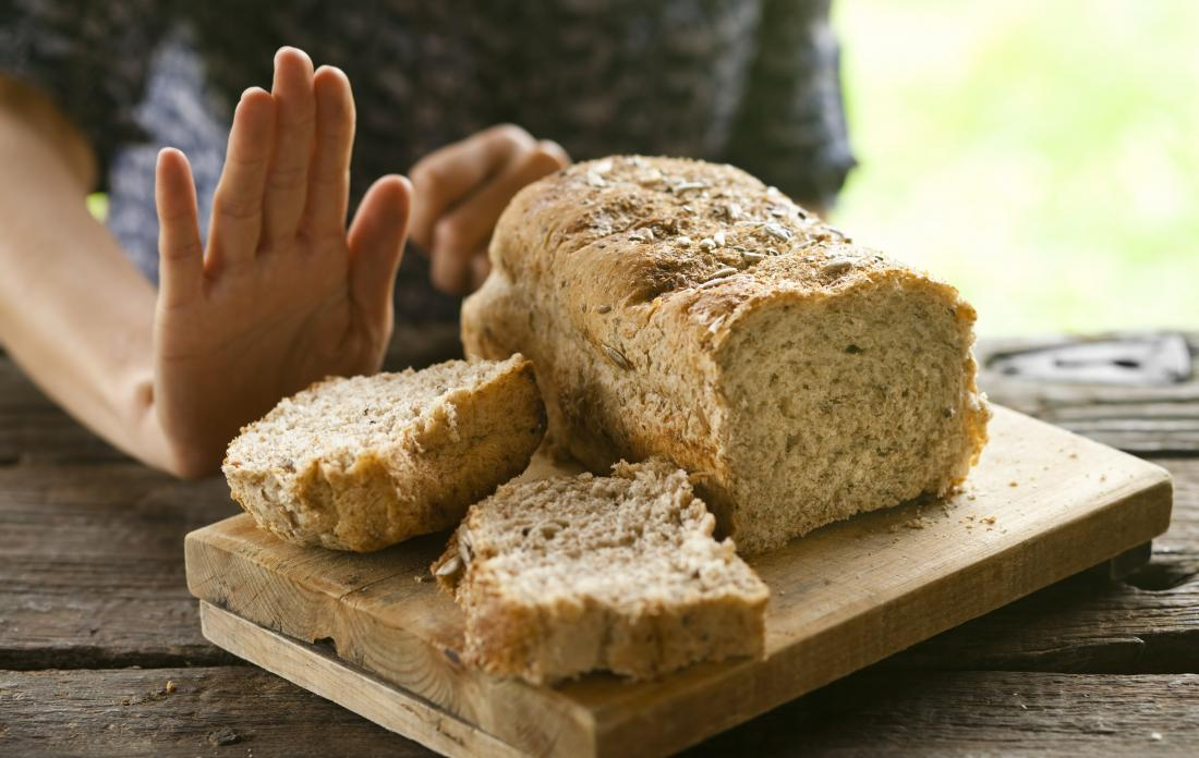 person refusing bread because of celiac disease.