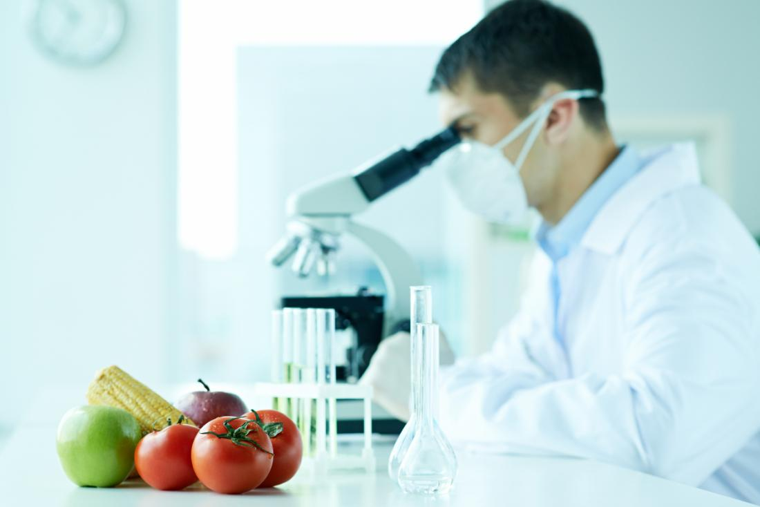 Food scientist doing research with microscope