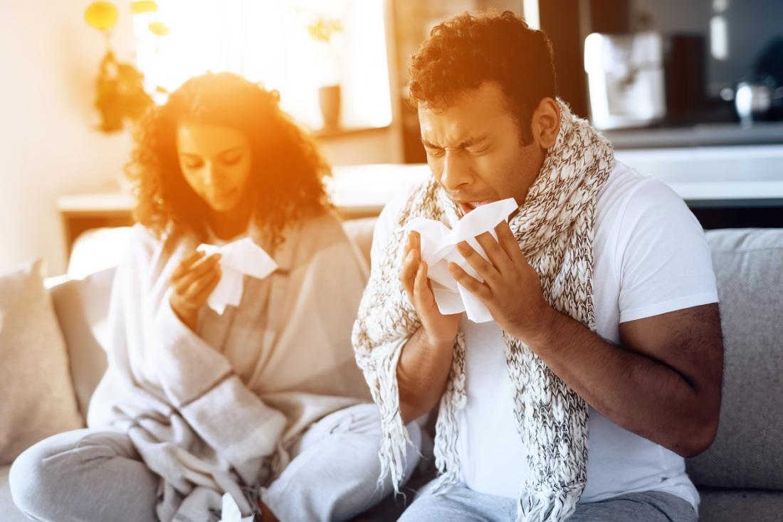 Man and woman with common cold