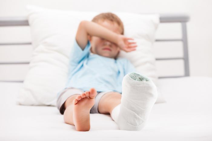 [Boy with broken leg]