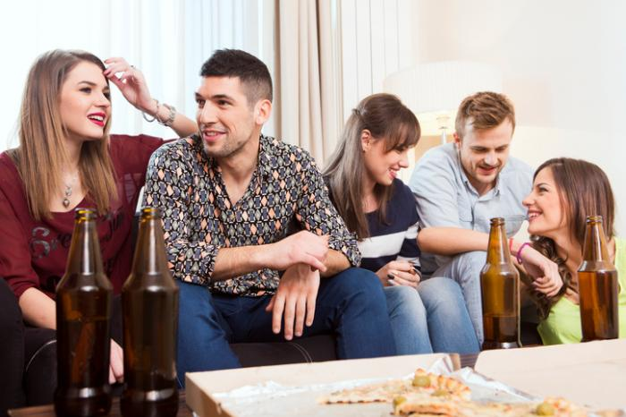 A group of young people drinking together