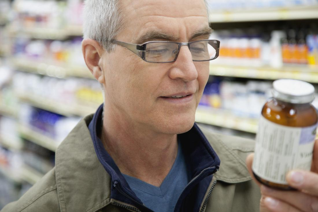 man checking supplements label