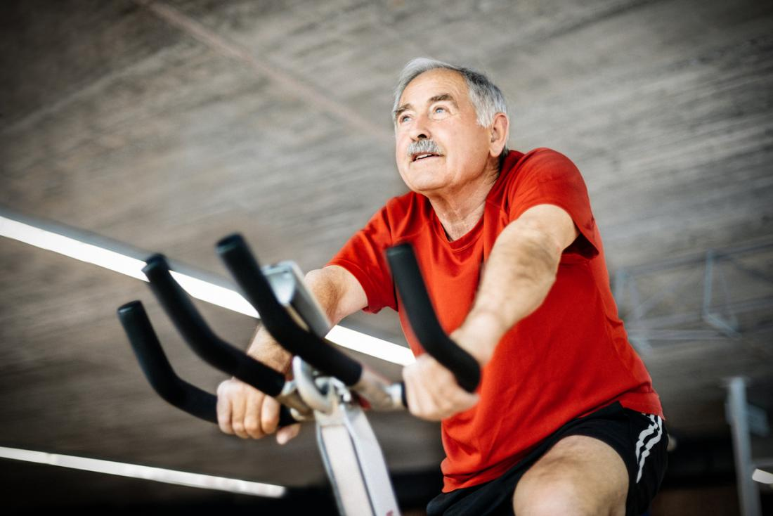 Old man on exercise bike