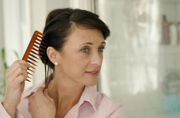 [body image - woman combing hair]