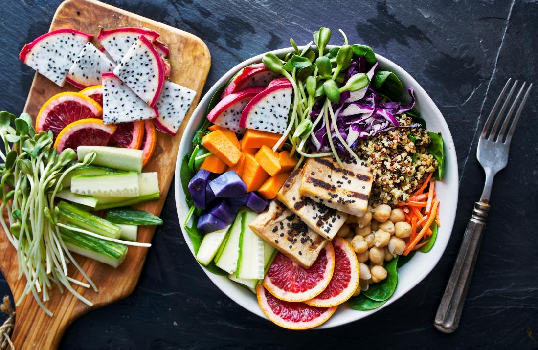 Grilled tofu and dragon fruit buddha bowl with vegetables, whole grain, and salad