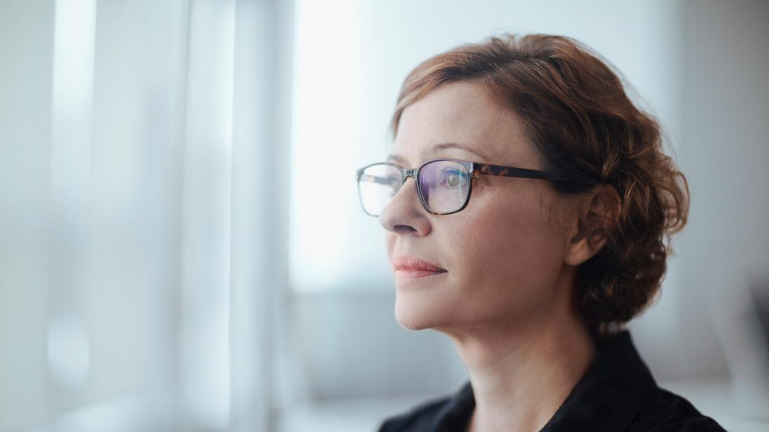 a woman looking pensive as she contemplates her polycystic ovary syndrome