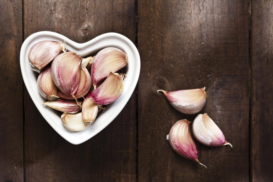 Garlic in heart-shaped bowl