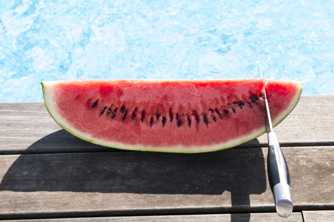 slice of watermelon with a knife
