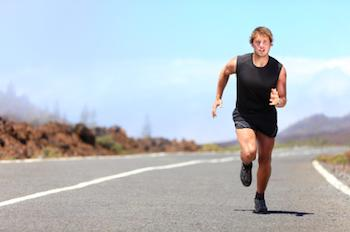 Athlete running on an open road