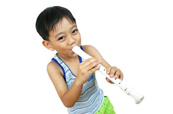 child playing a recorder